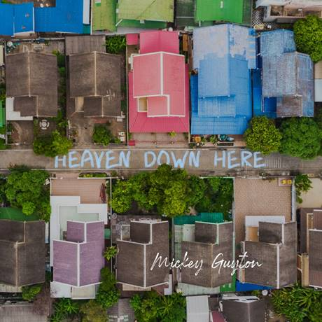 "MICKEY GUYTON MAKES A HEARTFELT PLEA WITH NEW SONG ""HEAVEN DOWN HERE"""